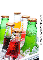 Assorted Soda Bottles in Ice Chest - Closeup of six assorted...