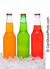 Assorted Soda Bottles Standing in Ice - Closeup of three...