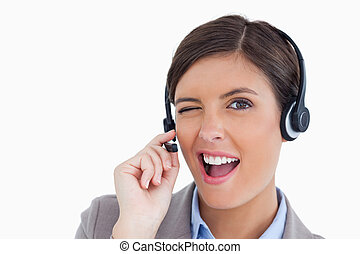 Close up of blinking call center agent against a white...