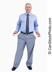 Mature tradesman showing his empty pockets