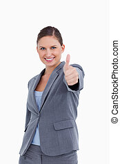 Smiling saleswoman giving her approval