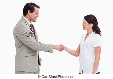 Side view of salespeople shaking hands
