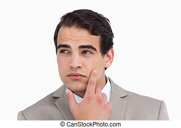 Close up of salesman in thoughts against a white background