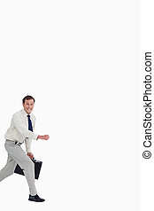 Businessman running with his suitcase