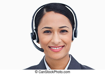 Close up of friendly smiling call center agent