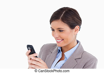 Close up of smiling female entrepreneur reading text message