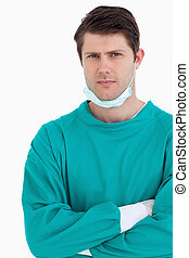 Close up of male doctor in scrubs