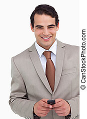 Close up of smiling salesman holding his cellphone