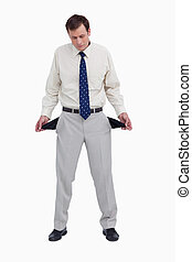 Bankrupt businessman showing his empty pockets