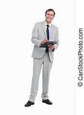 Smiling businessman ready to take notes against a white...