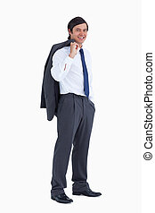 Side view of smiling tradesman with jacket over his shoulder...