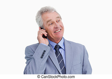 Close up of mature cheerful tradesman on his cellphone...