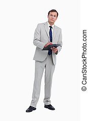 Businessman ready to take notes against a white background