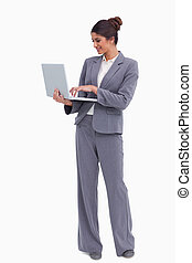 Smiling female entrepreneur working on her laptop