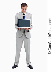 Businessman looking at the laptop he is presenting