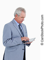 Side view of mature tradesman using tablet computer against...
