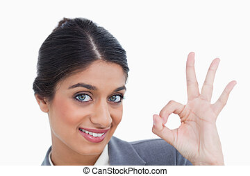 Close up of smiling female entrepreneur giving her approval