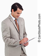 Salesman taking notes against a white background