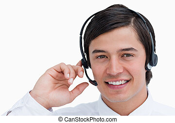Close up of smiling male call center agent in a conversation