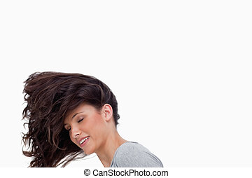 Young woman flipping her hair