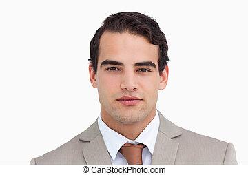 Close up of serious salesman