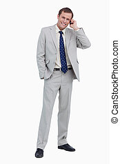 Smiling businessman on his mobile phone