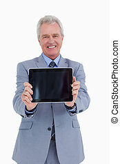 Smiling mature tradesman presenting screen of his tablet...