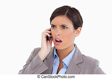 Close up of angry entrepreneur on her cellphone