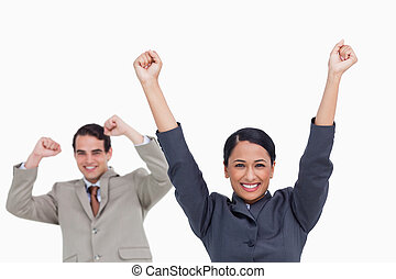 Cheering saleswoman with colleague behind her