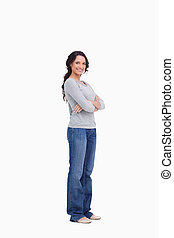 Smiling woman with her arms folded