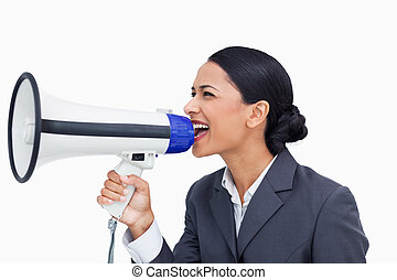 Close up of saleswoman shouting through megaphone against a...