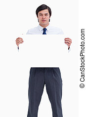 Tradesman holding blank sign