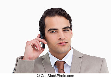 Close up of serious salesman on his mobile phone