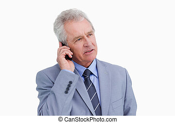 Close up of mature tradesman talking on his cellphone...