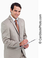 Smiling salesman with notepad and pen