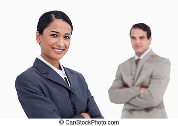 Smiling saleswoman with colleague behind her