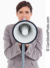 Close up of female entrepreneur shouting through megaphone...