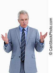 Clueless mature tradesman against a white background