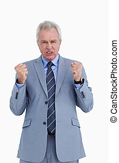Triumphant mature tradesman against a white background