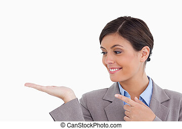 Close up of female entrepreneur looking and pointing at her palm against a white background