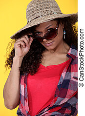 Woman wearing sunglasses and straw hat
