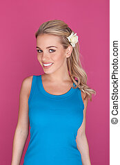 Smiling Blond Woman With Flower In Hair
