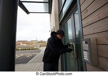Man unlocking the door to the office - A mature man...