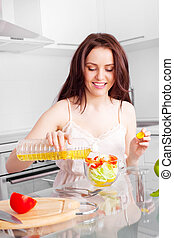 woman eating salad - beautiful young woman eating salad in...