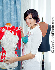 Dressmaker with mannequin working at home - Dressmaker with...