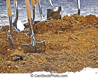 shiny shovels in dirt - Ground breaking ceremony with shiny...