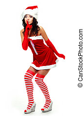 girl telling a secret - pretty young woman dressed as Santa...