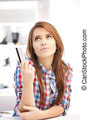 pensive woman with credit card - bright picture of pensive...