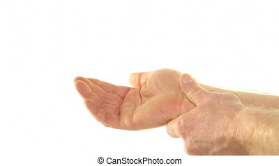Massage for Wrist Pain - The left hand of an adult male is...