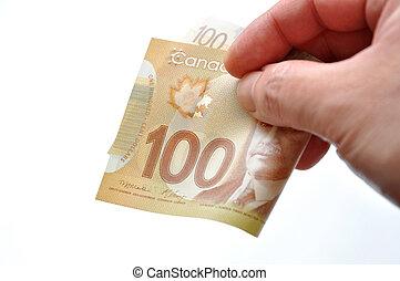 Handing new one hundred bill on white background